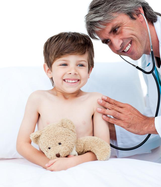 """Adorable little boy attending a medical checkup"" stock image"