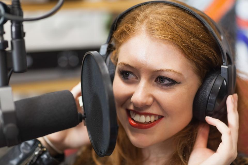 """Happy beautiful singer recording a song"" stock image"