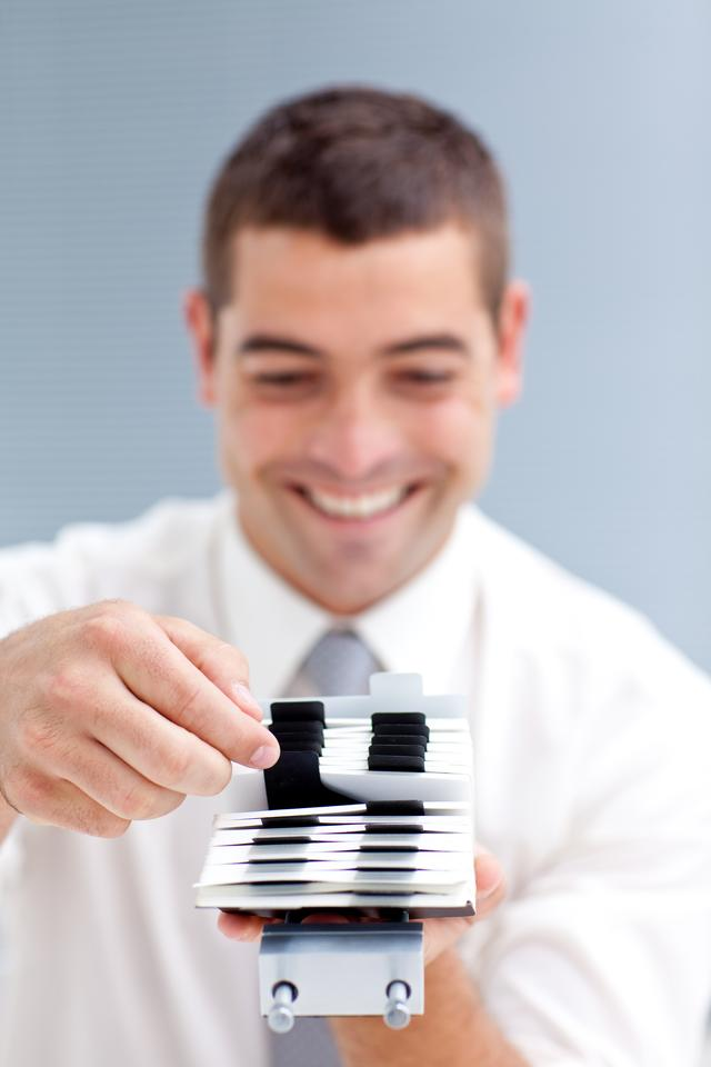 """""""Businesscard holder with a businessman"""" stock image"""