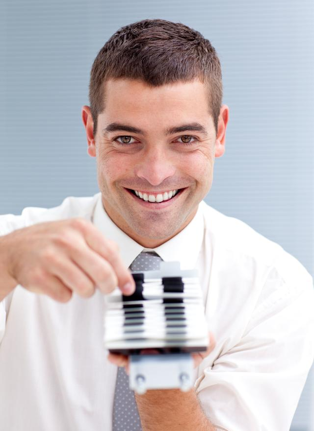 """""""Attractive businessman consulting a directory"""" stock image"""