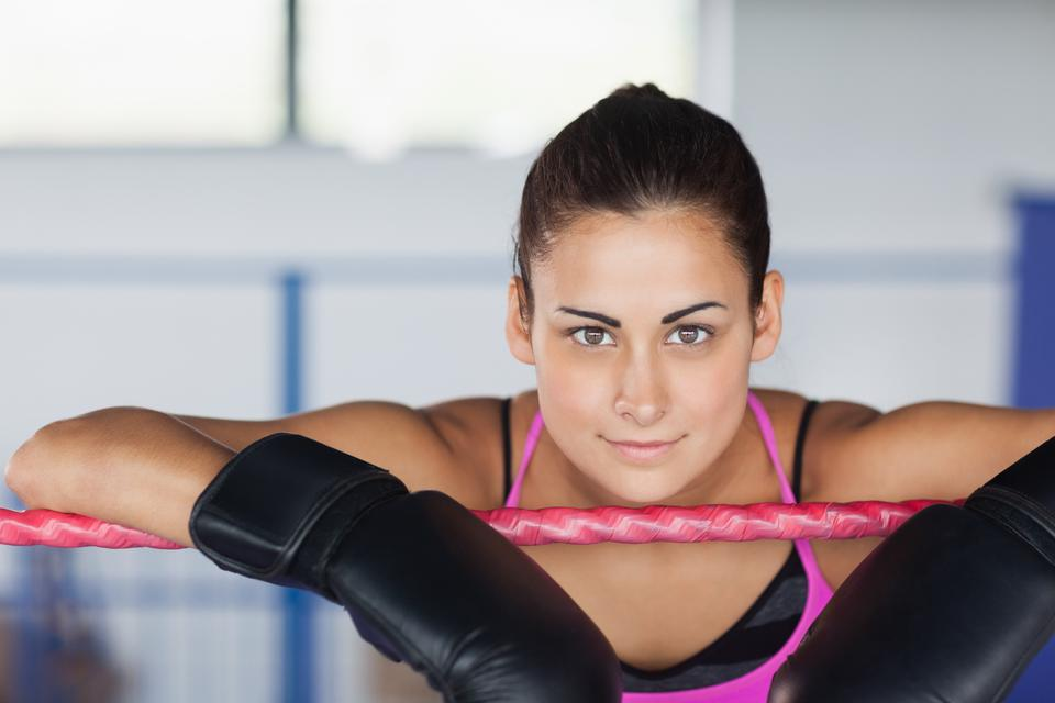"""""""Beautiful young woman in black boxing gloves"""" stock image"""