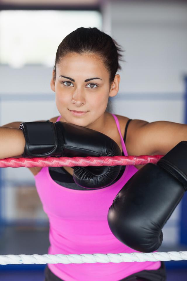 """""""Portrait of a beautiful woman in black boxing gloves"""" stock image"""