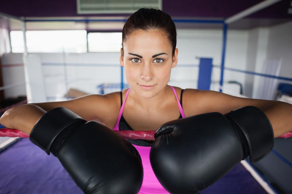 """""""Close up of a beautiful woman in black boxing gloves"""" stock image"""