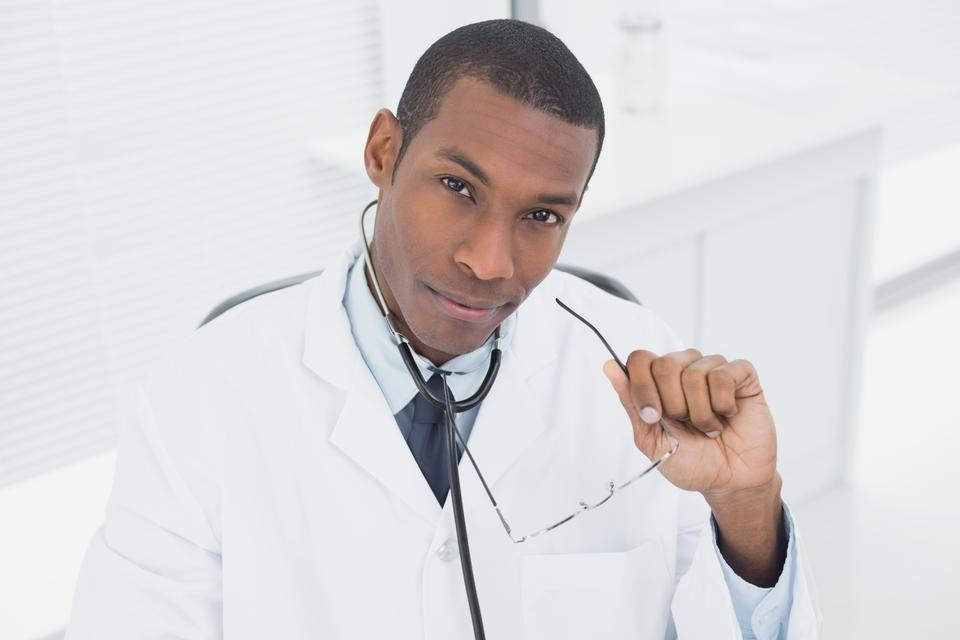 """""""Serious male doctor in medical office"""" stock image"""