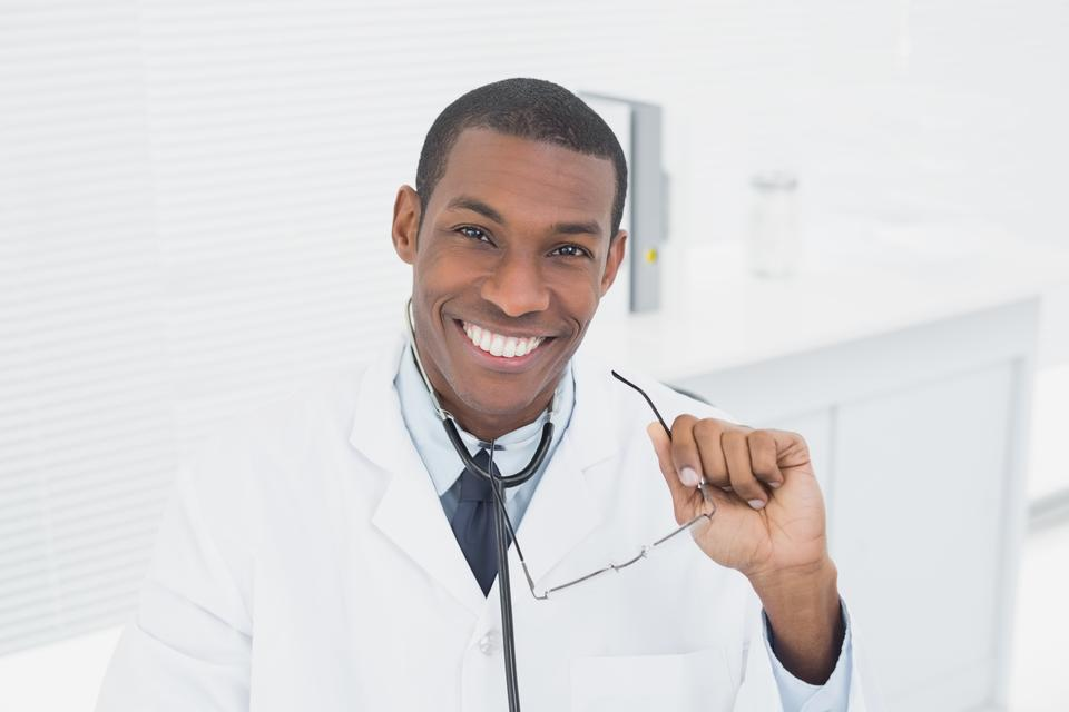 """""""Portrait of a smiling doctor in medical office"""" stock image"""