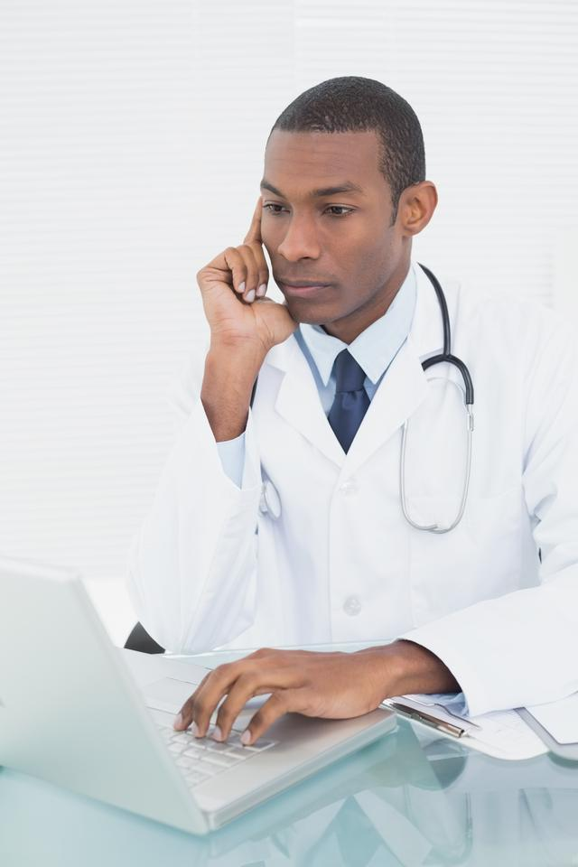 """""""Doctor using laptop at medical office"""" stock image"""