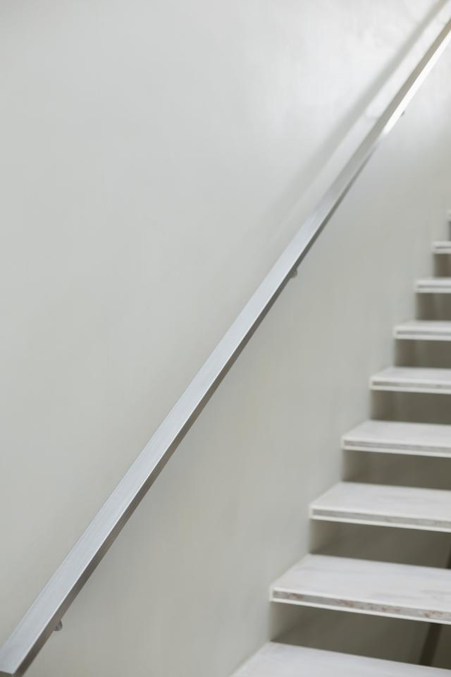 """""""Stairs and hand rails along white wall"""" stock image"""