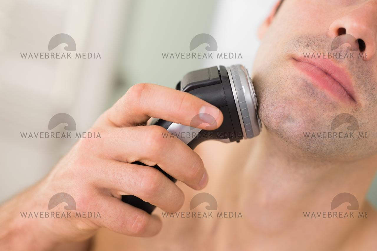 """""""Extreme Close up of man shaving with electric razor"""" stock image"""