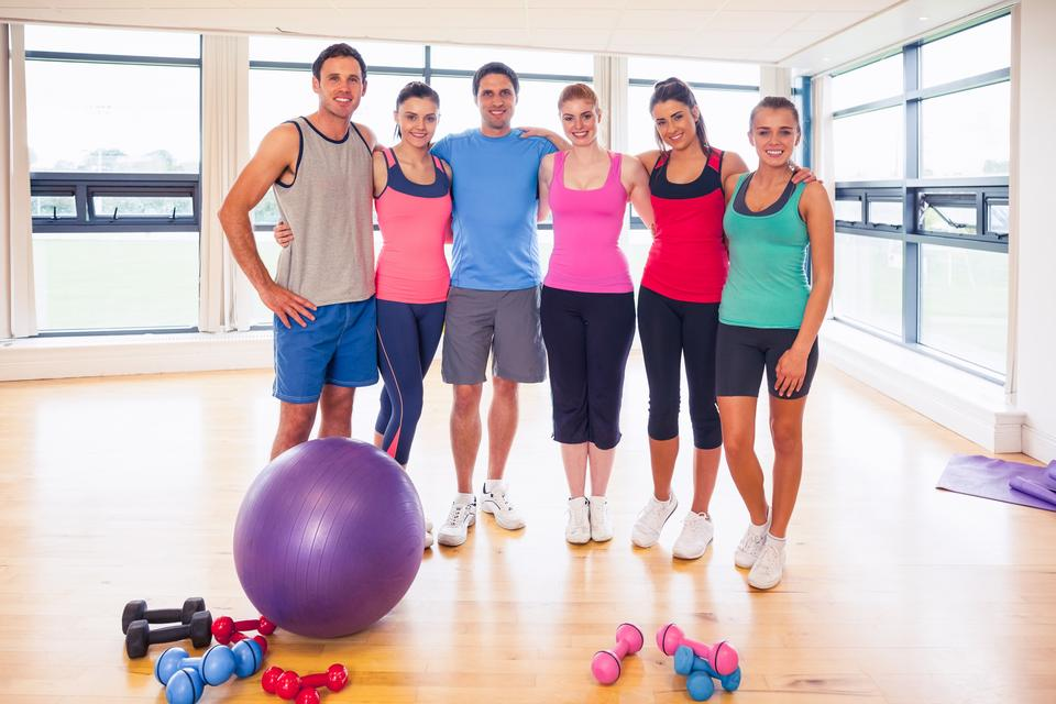 """Full length portrait of fitness class at exercise room"" stock image"