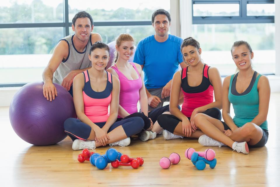 """Portrait of fitness class at a bright exercise room"" stock image"