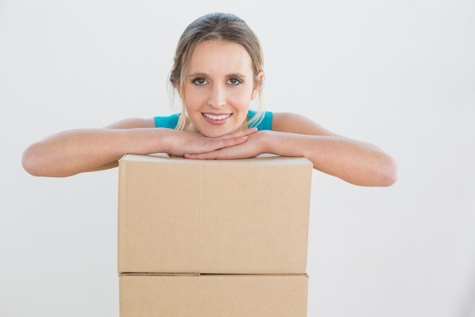 """""""Portrait of a young woman with a stack of boxes"""" stock image"""