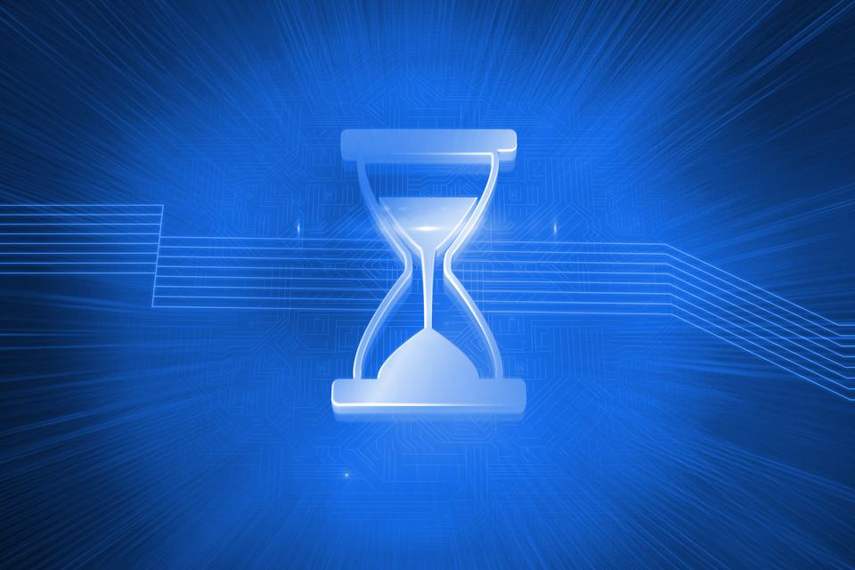 """Shiny hourglass on blue background"" stock image"