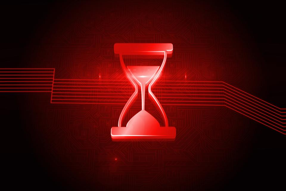 """Shiny red hourglass on black background"" stock image"