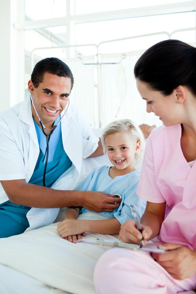 """Young patient at a checkup in a hospital"" stock image"