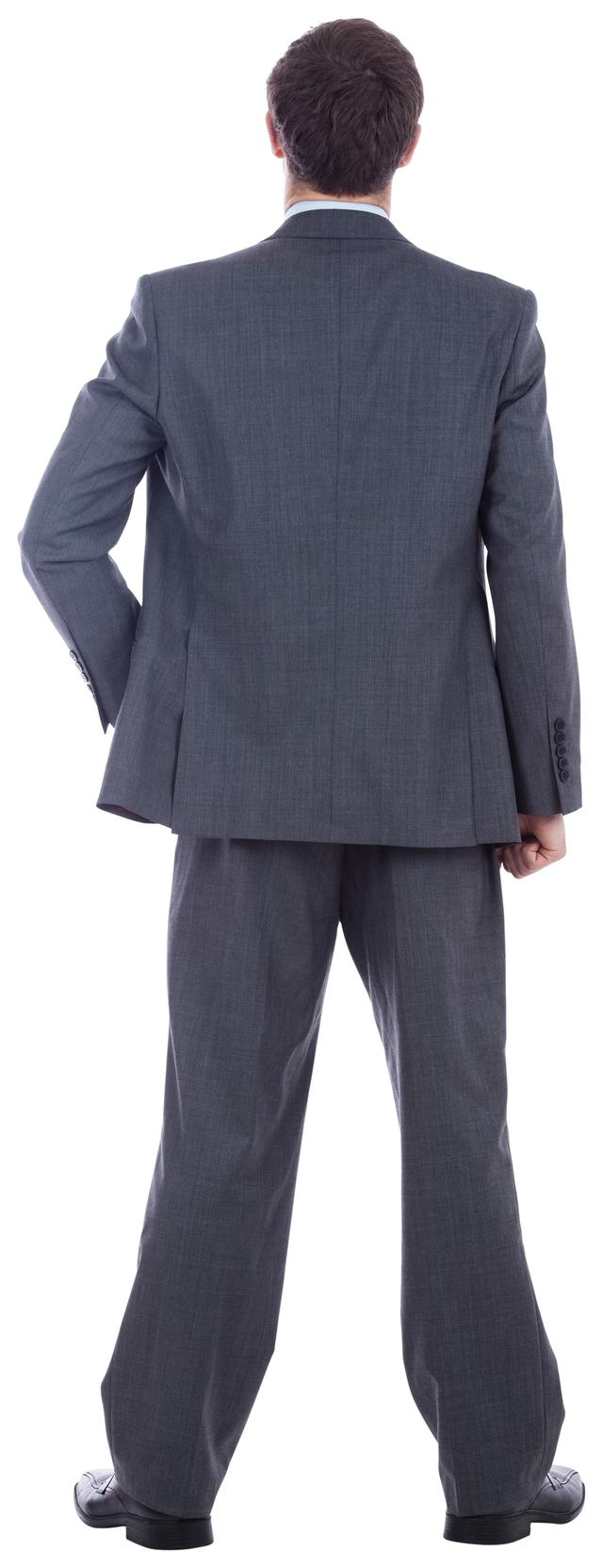 """Businessman standing with hand on hip"" stock image"