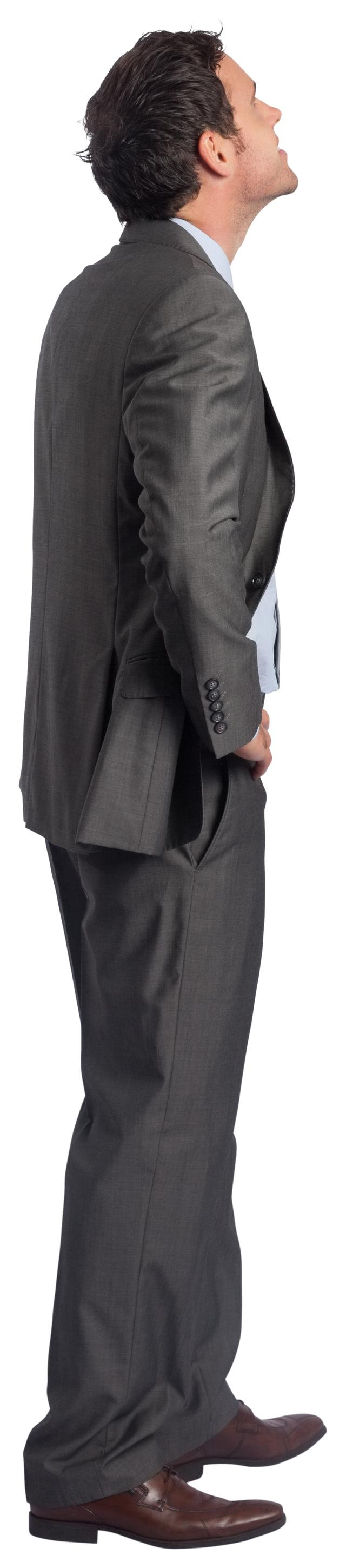 """Smiling businessman with hand on hip"" stock image"