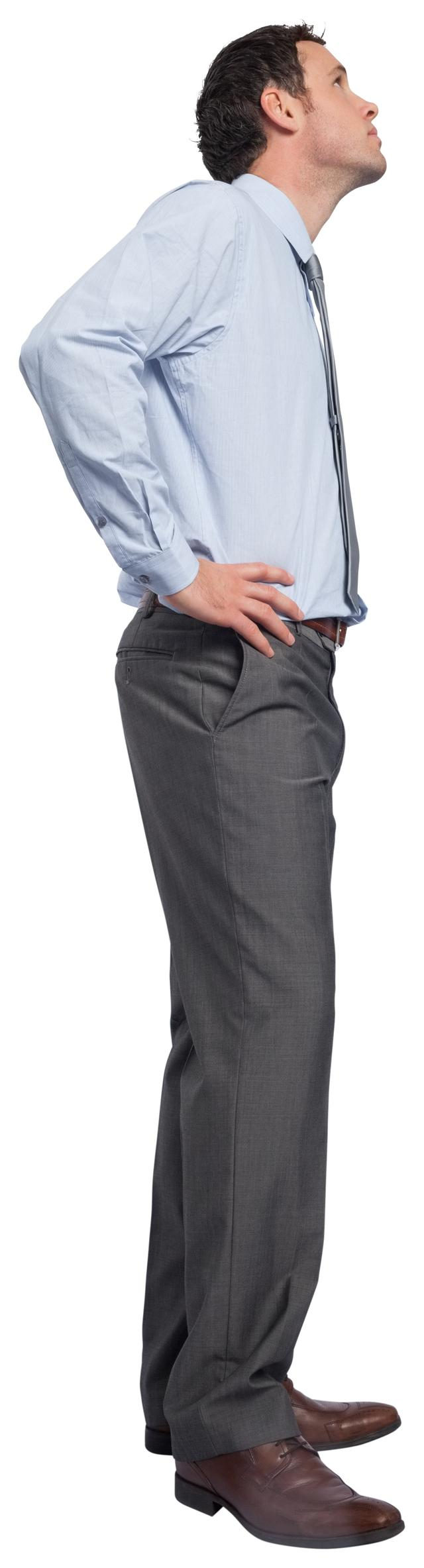 """Serious businessman with hand on hip"" stock image"