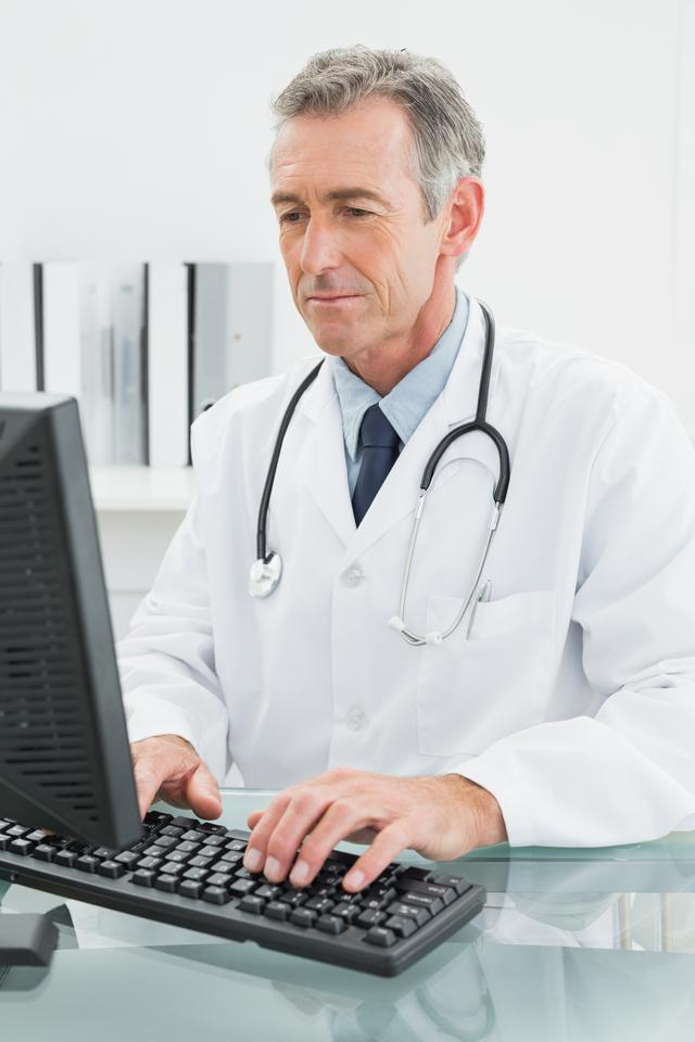 """""""Doctor using computer at medical office"""" stock image"""