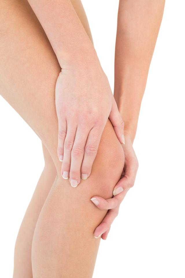 """""""Closeup mid section of a woman with knee pain"""" stock image"""