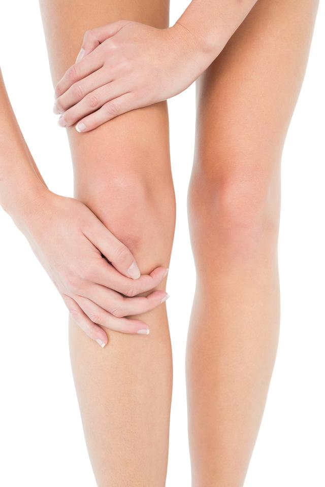 """""""Closeup mid section of a young woman with knee pain"""" stock image"""