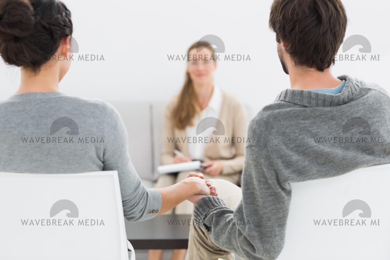 Female Relationship Counselor In Meeting With Young Couple License