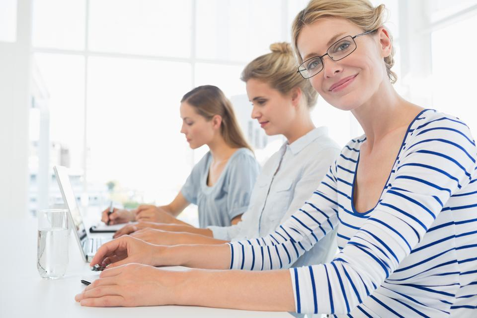 """""""Concentrated people working in office"""" stock image"""