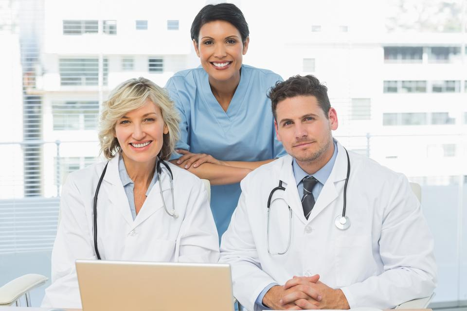 """""""Doctors with laptop at the medical office"""" stock image"""