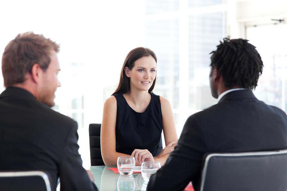 """Female leader with two salesmen"" stock image"