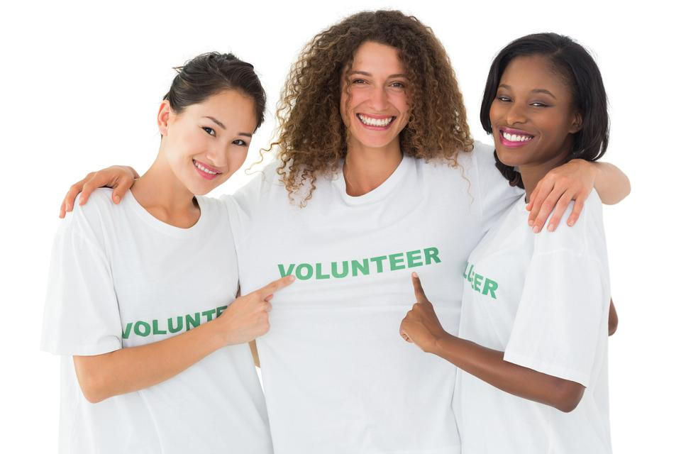 """Attractive team of volunteers smiling at camera"" stock image"