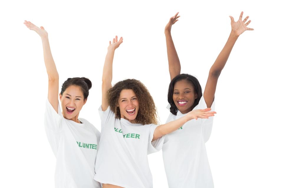 """Attractive team of volunteers waving at camera"" stock image"