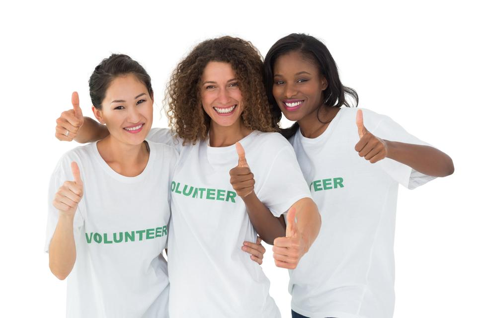 """Attractive team of volunteers giving thumbs up at camera"" stock image"