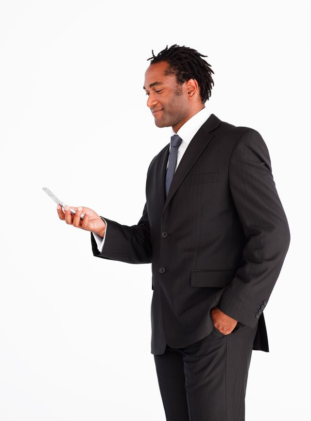 """Businessman sending text message"" stock image"