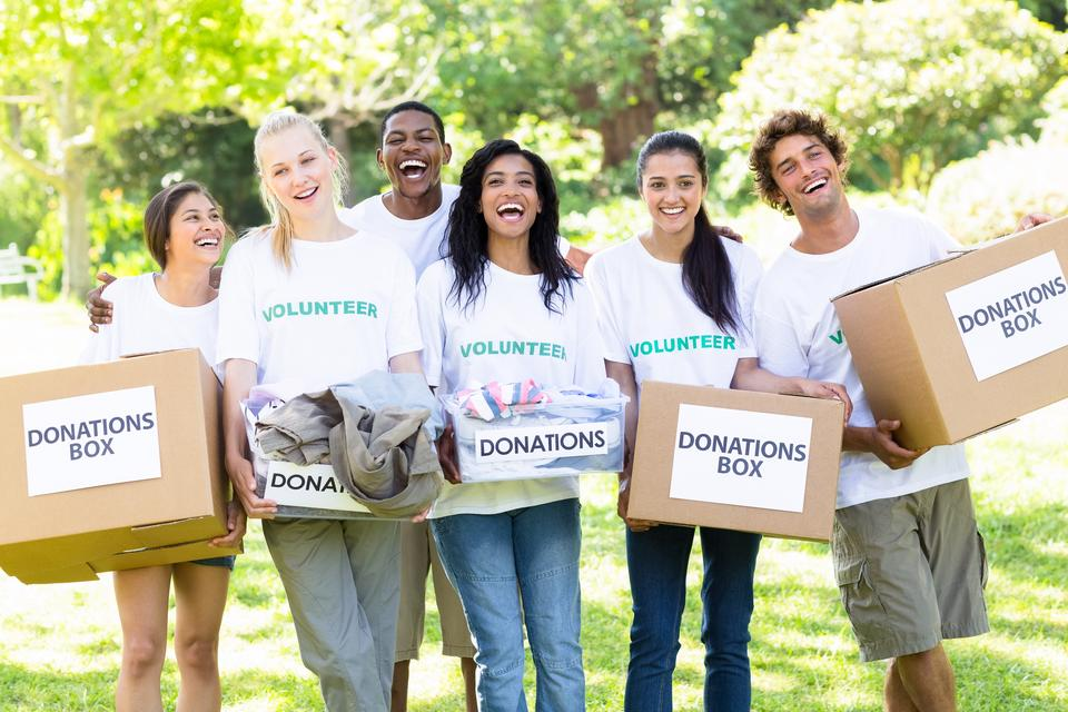 """""""Volunteers carrying donation boxes in park"""" stock image"""