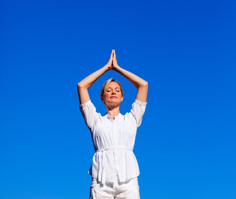 """Attractive woman practising meditation"" stock image"