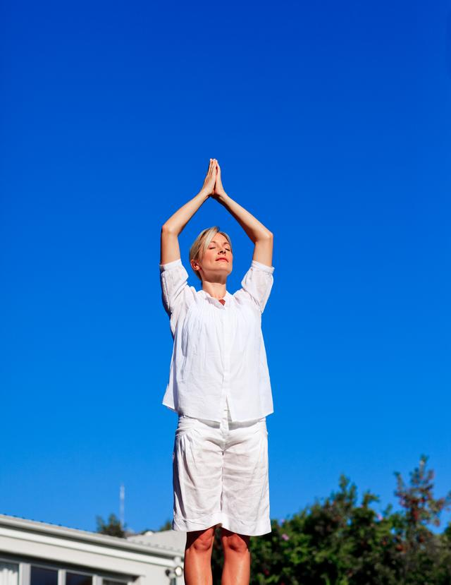 """Young woman practising yoga"" stock image"
