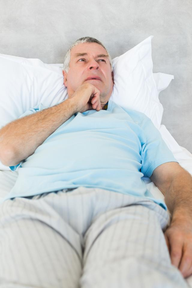 """""""Thoughtful senior man in bed"""" stock image"""