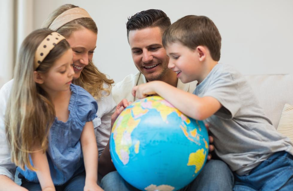 """""""Family searching places on globe"""" stock image"""