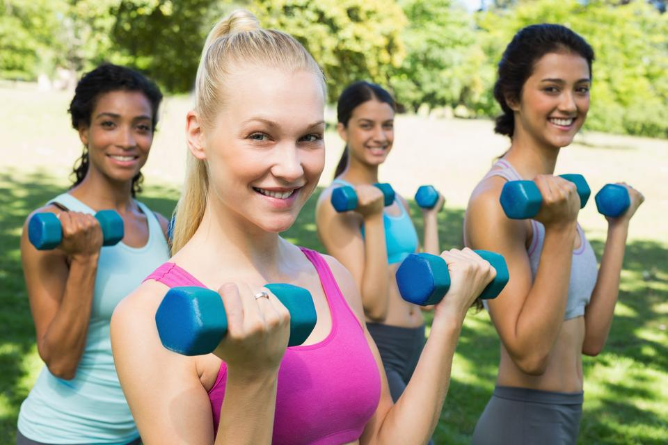 """""""Multiethnic sporty women weightlifting"""" stock image"""