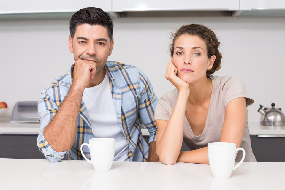 """""""Fed up couple having coffee looking at camera"""" stock image"""