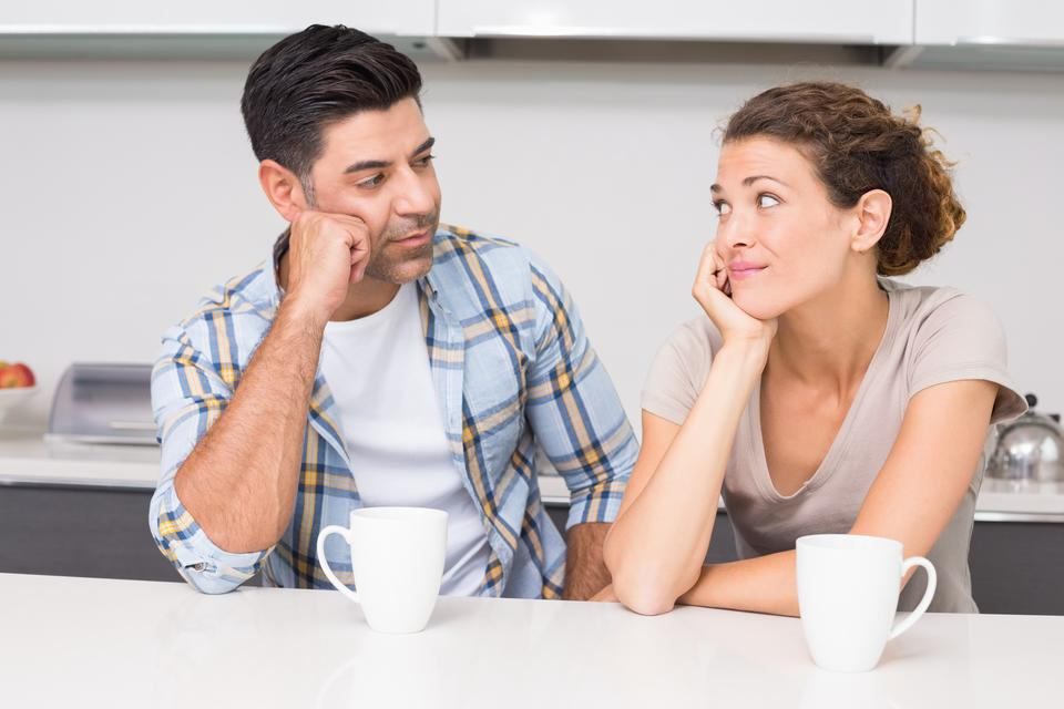 """""""Fed up couple having coffee looking at each other"""" stock image"""