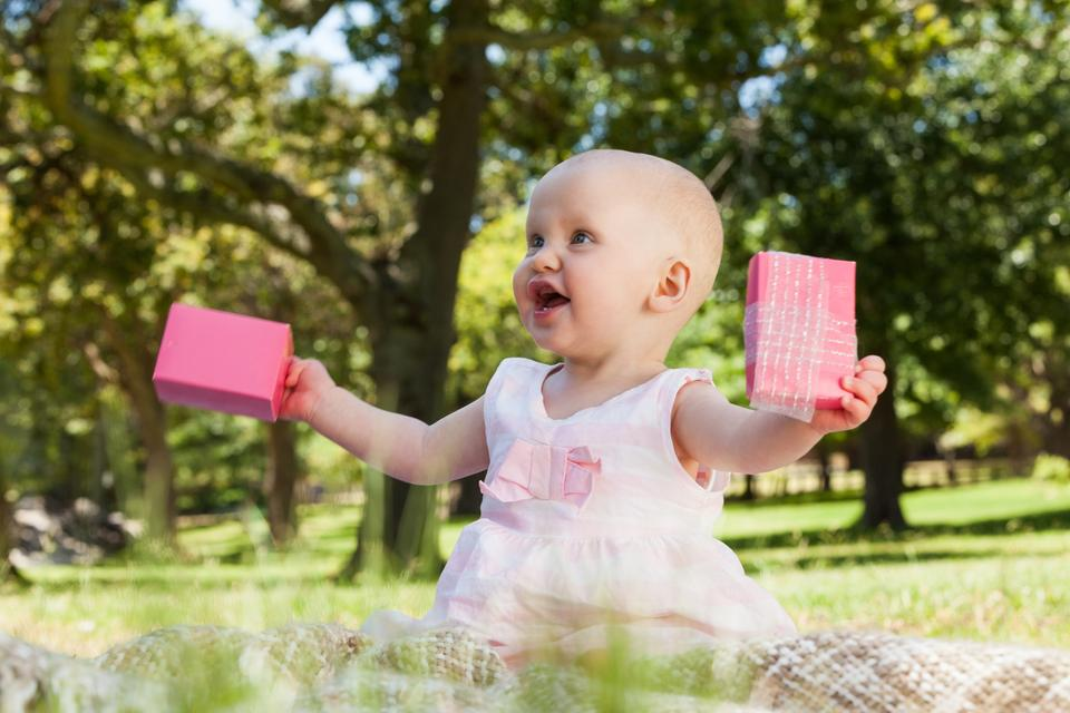 """""""Cute baby with box at the park"""" stock image"""