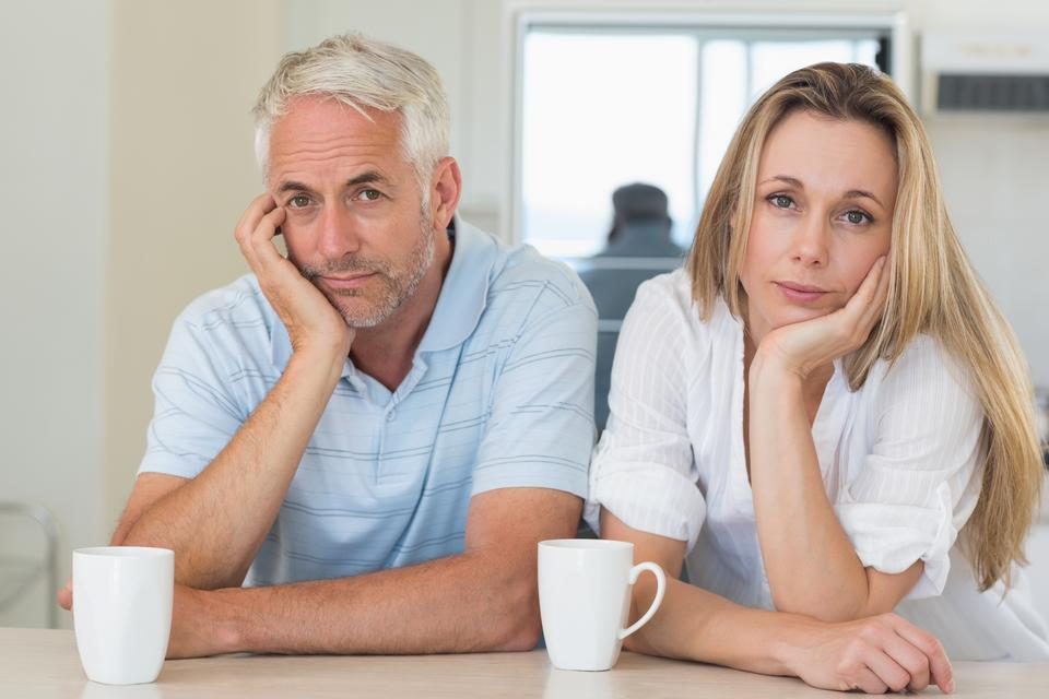 """""""Fed up couple sitting at the counter"""" stock image"""