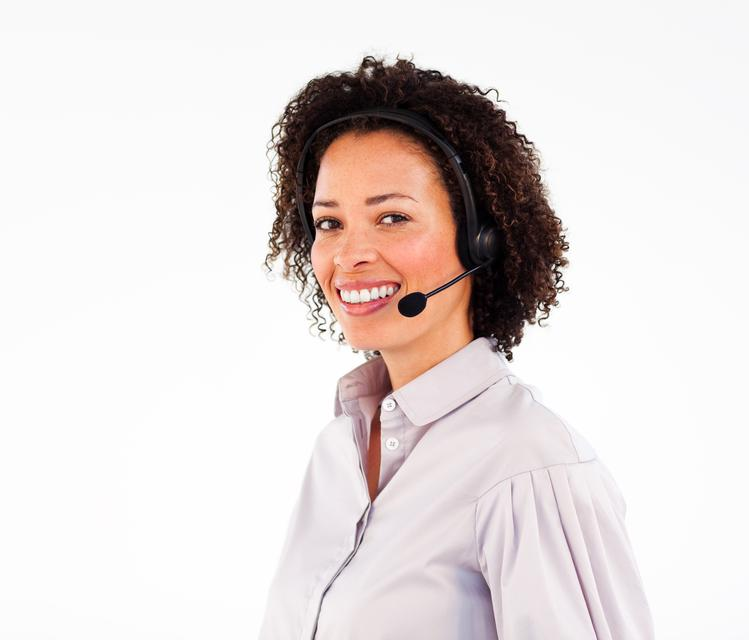 """""""Smiling operator working with headset"""" stock image"""