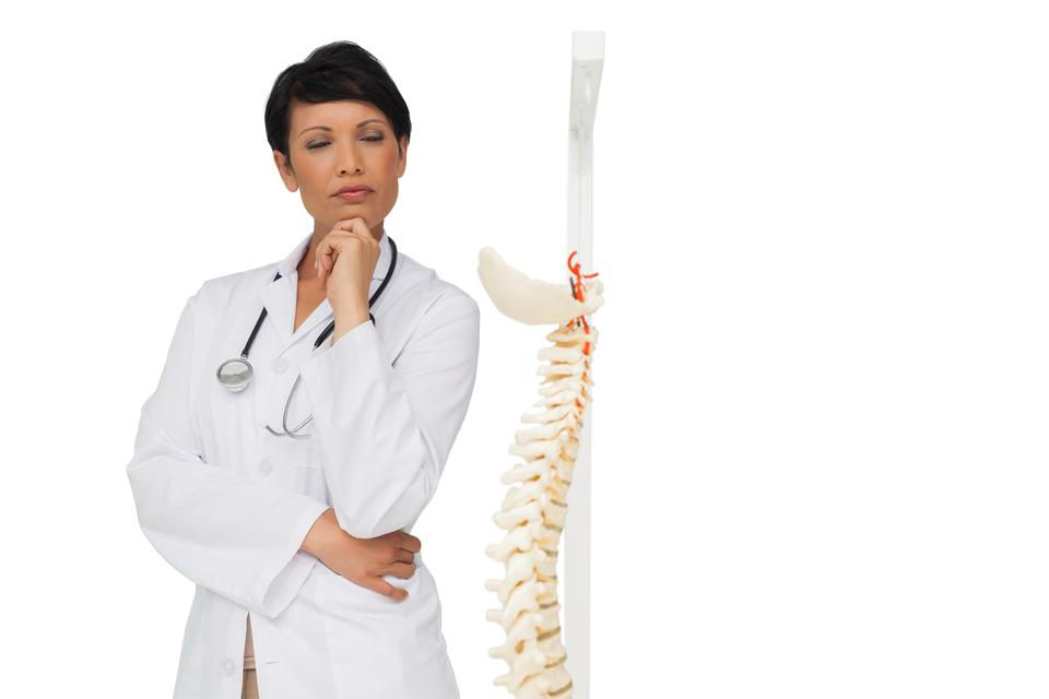 """Thoughtful female doctor with skeleton model"" stock image"