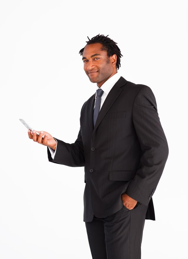 """Young businessman sending text message"" stock image"