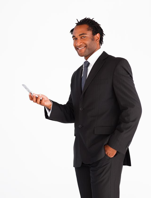 """Serious businessman sending text message"" stock image"