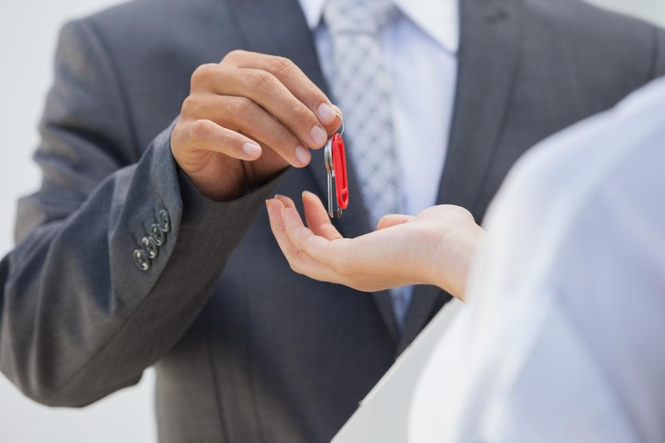 """""""Estate agent giving the key to buyer"""" stock image"""