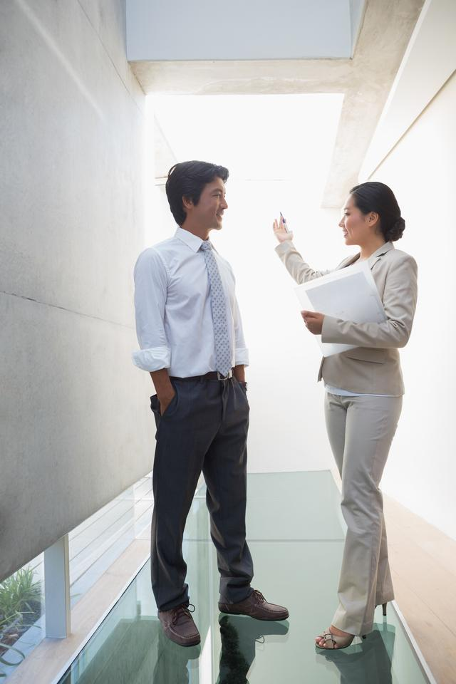 """""""Estate agent speaking with potential buyer"""" stock image"""