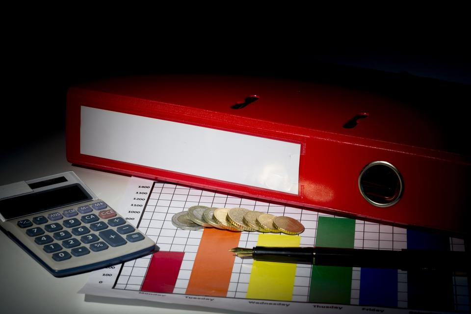 """Red business binder on a desk"" stock image"
