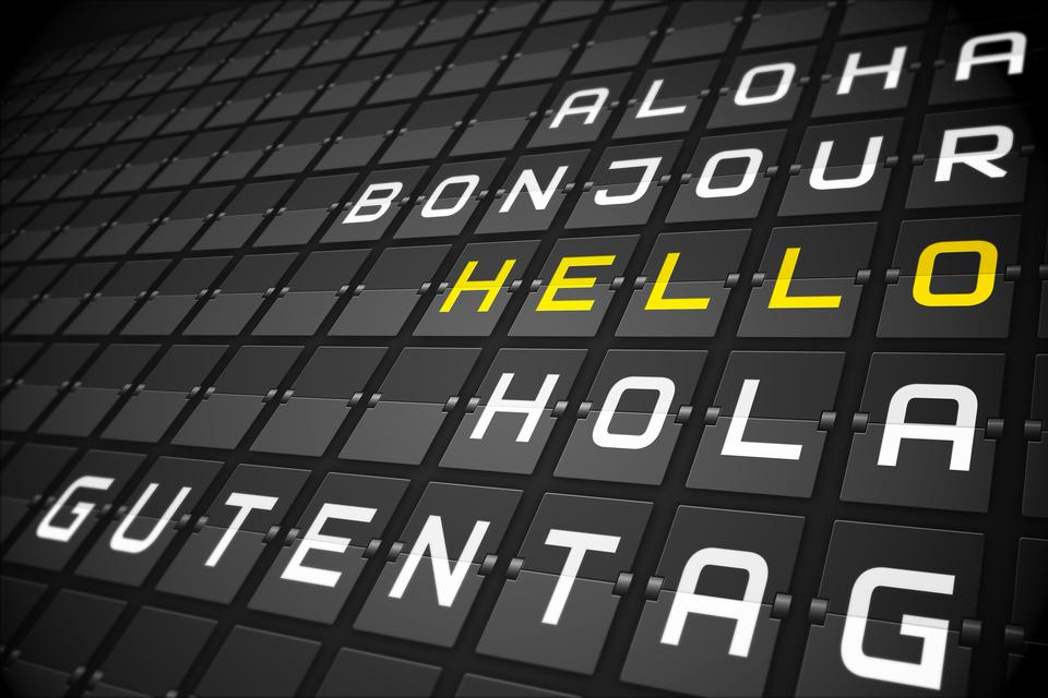 """Hello in languages on black mechanical board"" stock image"
